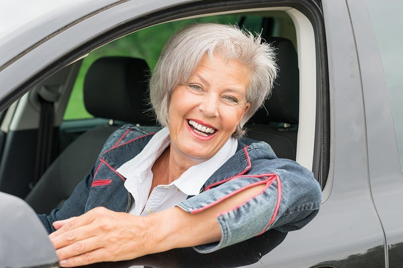 senior driving woman
