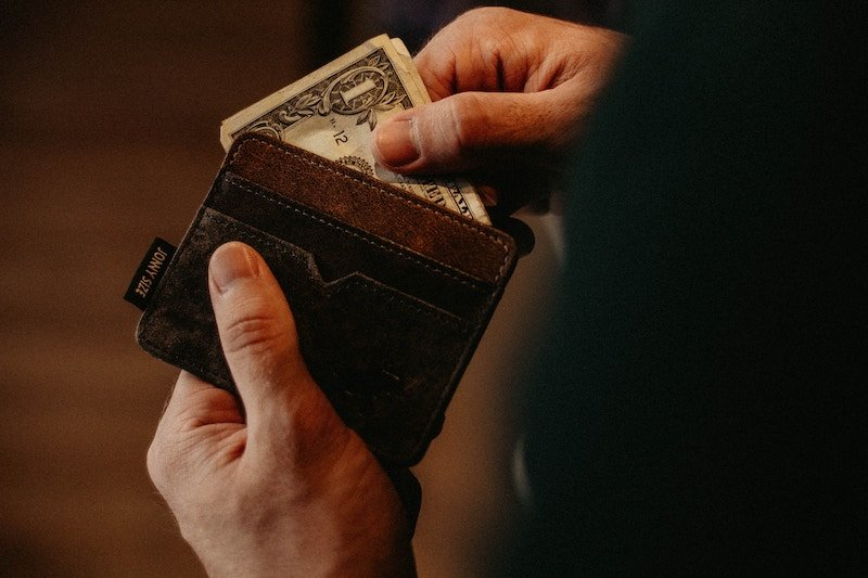 money being pulled from a wallet